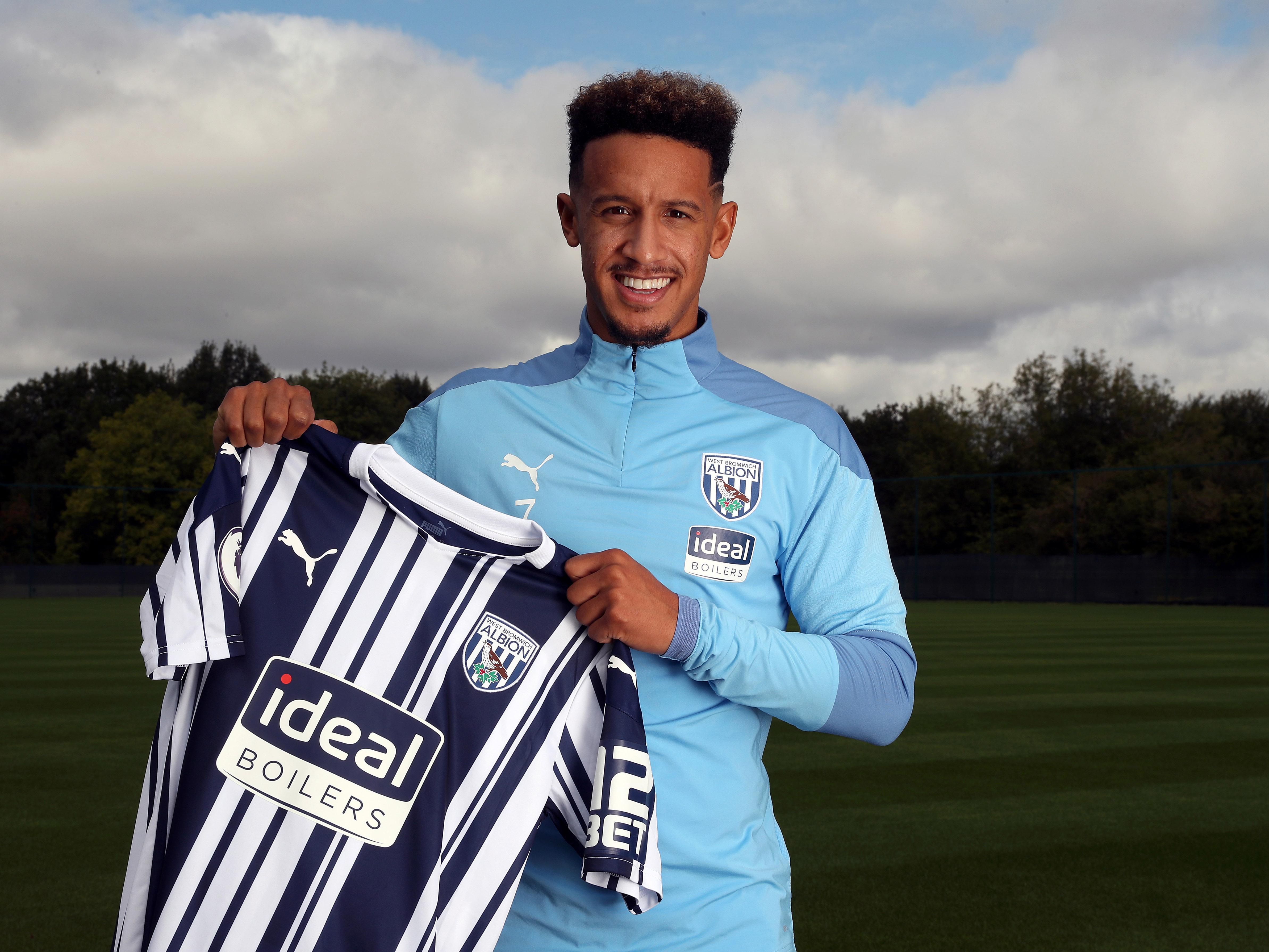 Callum Robinson poses for pictures after joining the Baggies permanently