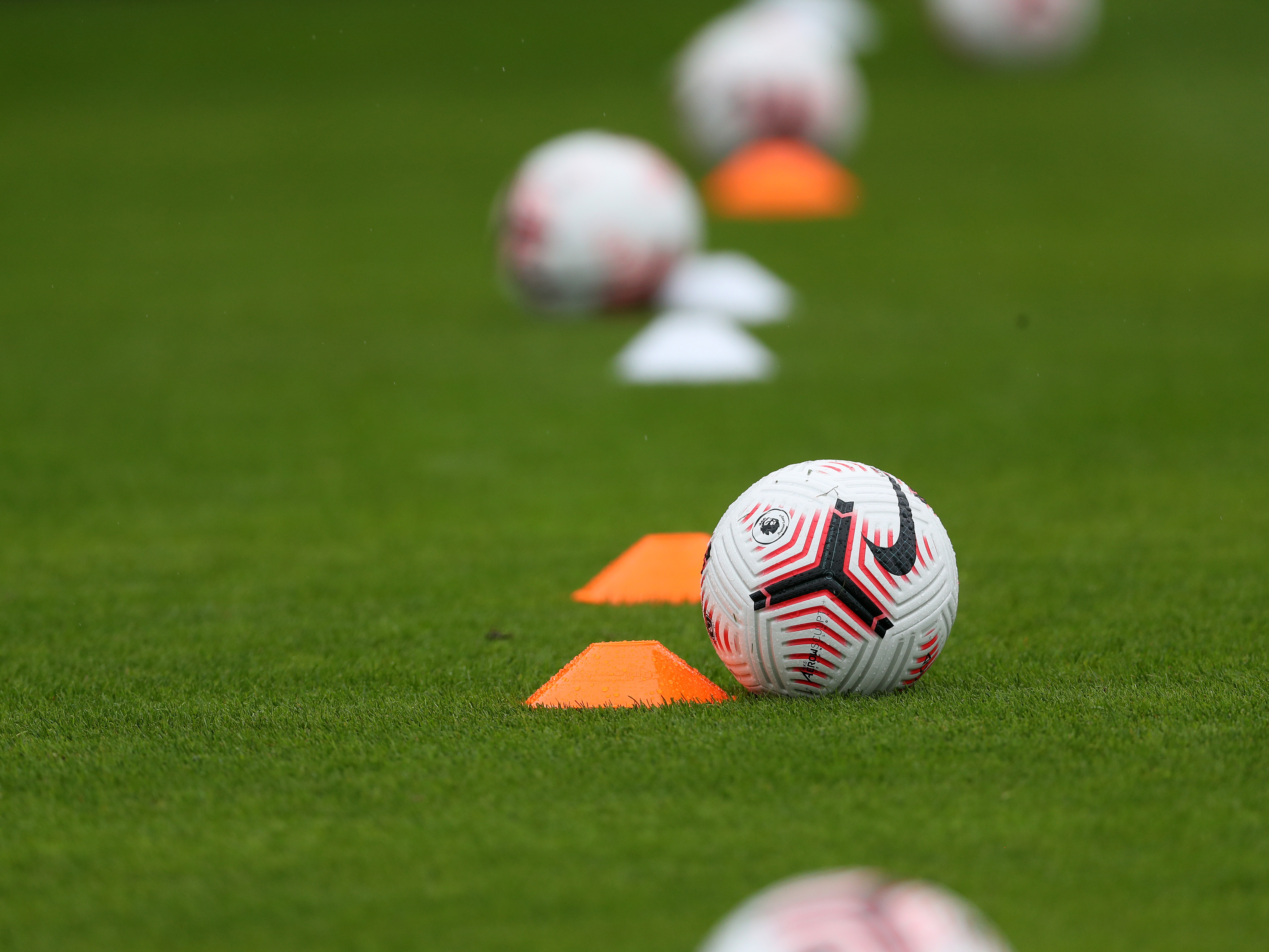 Premier League ball and cones